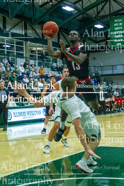 BLOOMINGTON, IL - November 12: Nigel Ferrell leaps for the bucket taking out Peter Lambesis on the way during a college basketball game between the IWU Titans  and the Blackburn Beavers on November 12 2019 at Shirk Center in Bloomington, IL. (Photo by Alan Look)