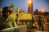 Egyptian military troops guard the road, protecting anti-Morsi demonstrators on Kasr al-Nile Bridge, leading to Tahrir Square, in Cairo.