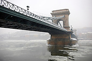 North Side of the Szechenyi Lanchid (Chain Bridge) in the winter snow. Budapest Hungary stock photos. .<br /> <br /> Visit our HUNGARY HISTORIC PLACES PHOTO COLLECTIONS for more photos to download or buy as wall art prints https://funkystock.photoshelter.com/gallery-collection/Pictures-Images-of-Hungary-Photos-of-Hungarian-Historic-Landmark-Sites/C0000Te8AnPgxjRg