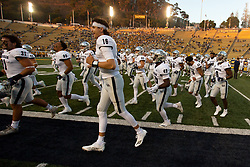 Nevada players retreat to the locker room for last minute instructions before an NCAA college football game against California, Saturday, Sept. 4, 2021, in Berkeley, Calif. (AP Photo/D. Ross Cameron)