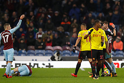 Watford's Marvin Zeegelaar (right) reacts after being shown a red card by referee Lee Probert (right) during the Premier League match at Turf Moor, Burnley.
