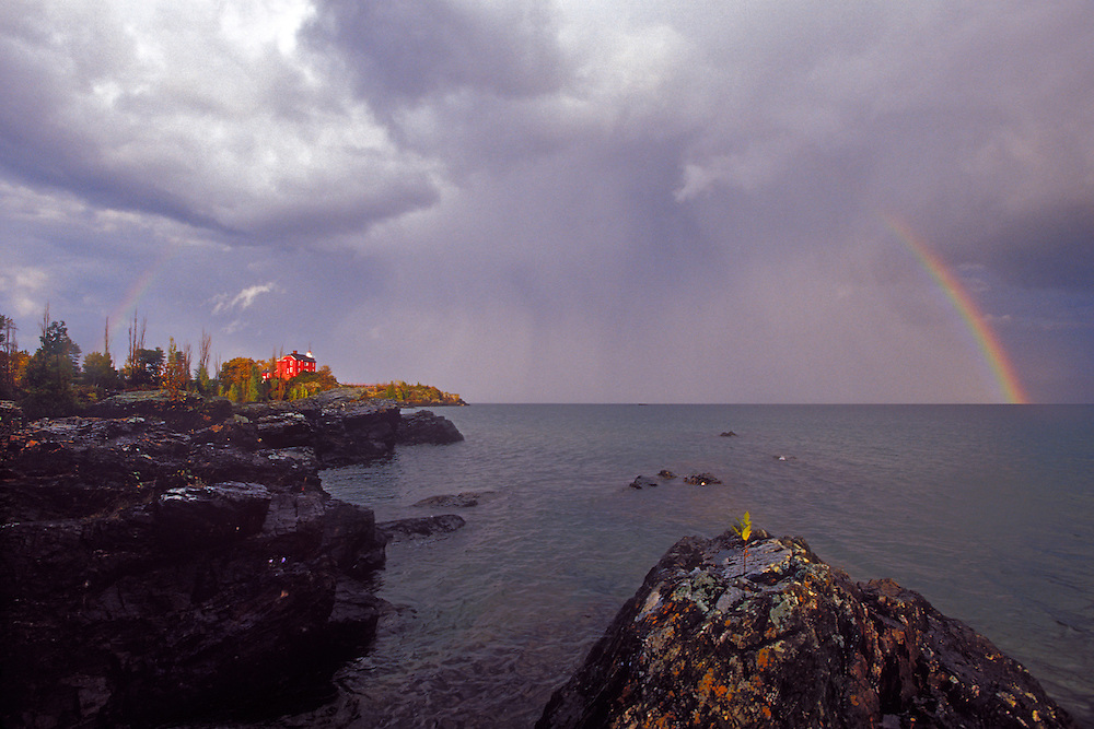 A rainbow arches over the Marquette Lighthouse in Marquette Michigan on Lake Superior.