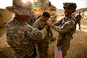 Soldiers of the 3rd platoon of the 10th mountain division during a fire fight with the taleban in the district center of Sharc in Logar province, Afghanistan on Tuesday, May 12th 2009...Photo: Guilad Kahn..A Soldier wounded during the fight being welcomed back at COP Bauguess.