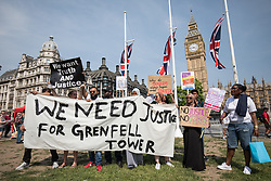 © Licensed to London News Pictures. 21/06/2017. London, UK. 'Day of Rage' protesters in Parliament Square during a demonstration demanding justice for the victims of the Grenfell Tower fire and an end to the current Conservative government. Photo credit: Rob Pinney/LNP