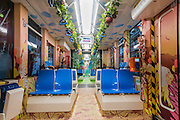 """GUANGZHOU, CHINA - JULY 24: (CHINA OUT) <br /> <br /> People take a tramcar decorated with the theme of The Wizard of Oz  in Guangzhou, China. """"The Wizard Of Oz"""" tramcar is the first green-themed tramcar for environmental transport in China. <br /> ©Exclusivepix Media"""