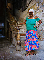 HAVANA, CUBA - CIRCA JANUARY 2020: Portrait of Cuban Woman standing on the entrance of an old building in Havana.