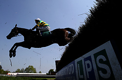 Easy Street ridden by jockey Richie McLernon during the Qatar Airways Handicap Chase during Kids Carnival Day of The Qatar Airways May Racing Carnival at Warwick Racecourse.