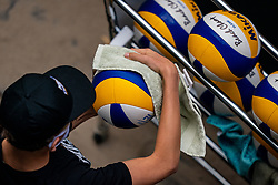 Covid-19 rule cleaning match balls during the last day of the beach volleyball event King of the Court at Jaarbeursplein on September 12, 2020 in Utrecht.