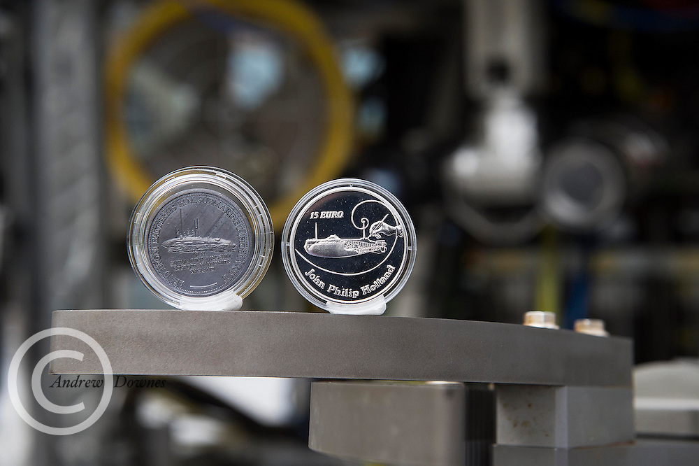 01/09/2014  repro free The Central Bank of Ireland will launched a €15 limited edition Silver Proof collector coin to commemorate John Philip Holland [1841 - 1914], the Irish born inventor of the modern submarine at the Marine Institute in Oranmore Co. Galway The coin is seen here with a mediallion created from the Original Holland 1 Batteries owned by Eamon Doyle from Limerick who brought it with him for the occasion . Picture:Andrew Downes