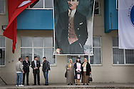 Kafkas University Graduate posing for photo under the Portrait of Ataturk and Turkish Flag...It is forbidden for woman to wear head-scarf at the territory of University.
