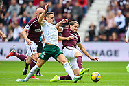 Kyle Magennis (#7) of Hibernian FC tackles Peter Haring (#5) of Heart of Midlothian FC during the Cinch SPFL Premiership match between Heart of Midlothian and Hibernian at Tynecastle Park, Edinburgh, Scotland on 12 September 2021.