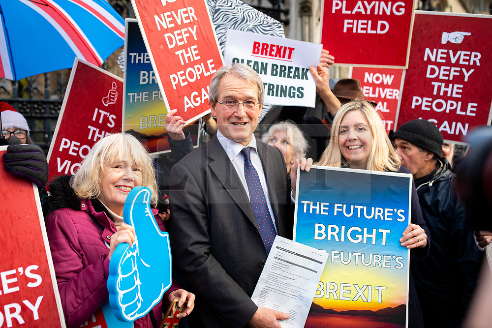 © Licensed to London News Pictures. 20/12/2019. London, UK. MPs Owen Paterson (centre) and Andrea Jenkyns (R) join Brexit supporters as they celebrate outside parliament after MPs voted to pass Boris Johnson's Withdrawal Agreement Bill. Photo credit: Rob Pinney/LNP