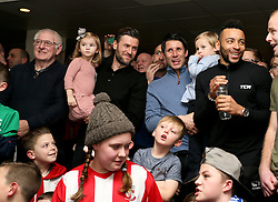 Lincoln City coaches Nicky (left) and Danny Cowley watch the Emirates FA Cup, Quarter Final draw with fans in the Travis Perkins bar at Sincil Bank, Lincoln.