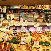 Counter at the world famous fish stand in the Pike Place Market, Seattle, USA. Here fishmongers sing, throw fish in the air and generally entertain the crowd. Oh - and they also sell some fish.