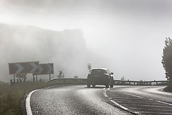 © Licensed to London News Pictures. 03/07/2015. Harrogate, UK. Picture shows drives struggling through thick fog near Harrogate. Hailstones the size of golf balls and fierce lightning storms battered homes yesterday but blue skies are set to return today . Temperatures are set to soar to 29C (82F) today. Photo credit : Andrew McCaren/LNP
