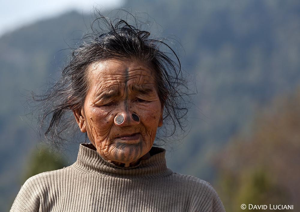 An Apatani woman posing while we are walking from Hong village to Hari vilage.