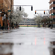 A person crosses an empty St. Clair Street along Jackson Street in Toledo on Wednesday, April 22, 2020. THE BLADE/KURT STEISS