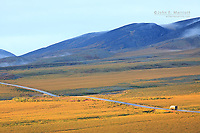 Semi-truck going north on the Dempster Highway towards Inuvik in the Yukon, Canada