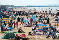 © Licensed to London News Pictures; 30/05/2021; Weston-super-Marel, UK. Crowds and people visit the beach and walk on the promenade on the late May bank holiday weekend during the covid coronavirus pandemic as restrictions have been eased to allow travel and staycations in England and Wales. The weather is forecast for this weekend to have the hottest day of the year so far. Photo credit: Simon Chapman/LNP.