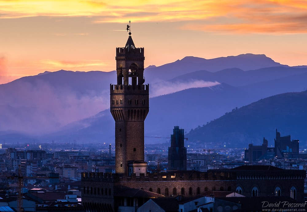 tower of Palazzo Vecchio in the distant dusk.