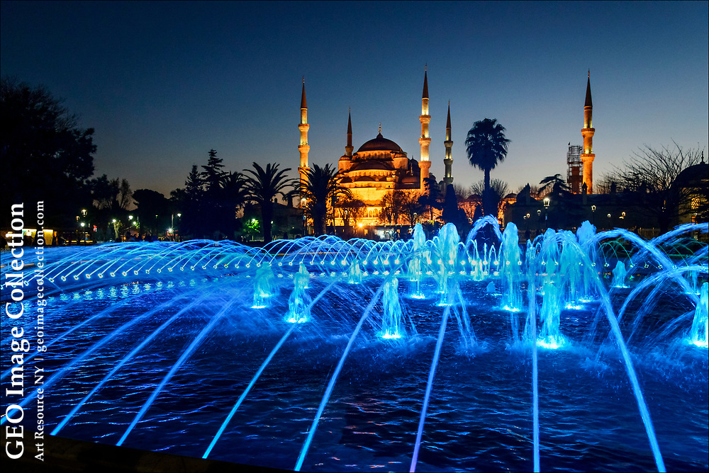 Istanbul's Blue Mosque, or Sultan Ahmet Mosque, is one of the city's most striking images and most photographed landmarks.  Colored lights in a fountain in front of the 17th century holy place add to the opulence, but it is actually blue tiles along the mosque's interior walls that give it the name the Blue Mosque.