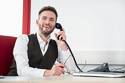 Manager phone smiling talking holding receiver