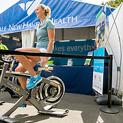 August 21, 2016, New Haven, Connecticut: <br /> Petra Kvitova of the Czech Republic rides a bike at the New Haven Health booth during WTA All-Access Hour on Day 3 of the 2016 Connecticut Open at the Yale University Tennis Center on Sunday, August  21, 2016 in New Haven, Connecticut. <br /> (Photo by Billie Weiss/Connecticut Open)