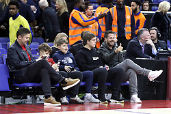 Barney Francis, Managing Director of Sky Sports (far left) and Jamie Redknapp (far right) in the crowd during the NBA London Game 2019 at the O2 Arena, London.