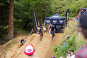 Adrien Loren (left), of France, and Martin Soderstrom, of Sweden, race each other during the Mons Royale Dual Speed and Style at the inaugural Crankworx Rotorua event held at Skyline Rotorua, Rotorua, New Zealand, March 25-29, 2015.