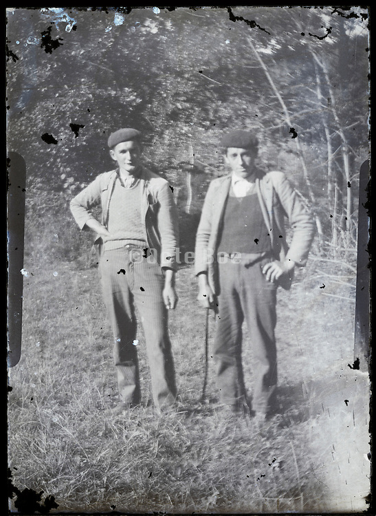 two farmers on a fading glass plate negative print Europe 1920s