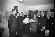Helping to make their first Christmas on the new Kish Lighthouse a happy one, the Australian Ambassador, His Excellency the Hon. S. Robertson, handed over three plum puddings, a gift from the Dried Fruit Growers of Australia, to the men who will man the Lighthouse this Christmas.  .10.12.1965