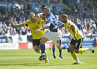 Photo: Steve Bond/Richard Lane Photography. Leicester City v Watford. Coca Cola Championship. 17/04/2010. Steve Howard (C) tries to break between Jay DeMerit (L) and Adrian Mariappa (R)