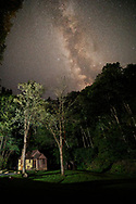 The cabins of Watoga State Park offer a glimpse at some of the darkest skies in the state of West Virginia as the milky way can be seen streaming above the forest canopy and a cabin tucked away into the heart of the forest.