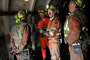 Miners are being briefed about Health and Safety Regulatnios by Stuart Beaumont (centre), the project manager, on Wednesday, Apr. 11, 2007, in Cwmgwrach, Vale of Neath, South Wales. The time is ripe again for an unexpected revival of the coal industry in the Vale of Neath due to the increasing prize and diminishing reserves of oil and gas, the uncertainties of renewable energy sources, and the technological advancement in producing energy from coal while limiting emissions of pollutants, has created the basis for valuable investment opportunities and a possible alternative to the latest energy crisis. Unity Mine, in particular, has started a pioneering effort to revive the coal industry in the area, reopening after more than 8 years with the intent of exploiting the large resources still buried underground. Coal could be then answer to both, access to cheaper and paradoxically greener energy and a better and safer choice than nuclear energy as a major supply for the decades to come. It is estimated that coal reserves in Wales amount to over 250 million tonnes, or the equivalent of at least 50 years of energy supply, while the worldwide total coal could last for over 200 years as a viable resource compared to only a few decades of oil and natural gas...