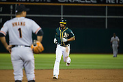 Oakland Athletics shortstop Marcus Semien (10) rounds the bases after hitting a grand slam home run against the San Francisco Giants at Oakland Coliseum in Oakland, California, on July 31, 2017. (Stan Olszewski/Special to S.F. Examiner)