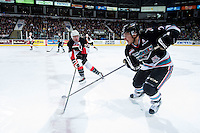 KELOWNA, CANADA - OCTOBER 23: Jared Bethune #21 of Prince George Cougars stick checks Tyson Baillie #24 of Kelowna Rockets on October 23, 2015 at Prospera Place in Kelowna, British Columbia, Canada.  (Photo by Marissa Baecker/Shoot the Breeze)  *** Local Caption *** Jared Bethune; Tyson Baillie;