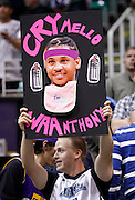 A Utah Jazz fan holds a sign with Denver Nuggets forward Carmelo Anthony pictured, during Game 6 of the NBA Western Conference first-round playoff series in Salt Lake City, Friday, April 30, 2010. The Jazz defeated the Nuggets 112-104, to advance. (AP Photo/Colin E Braley)