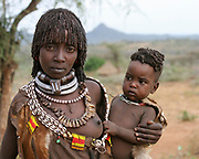 Hamer Tribeswoman holds her baby. Photographed in the Omo River Valley, Ethiopia