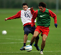 Photo: Javier Garcia/Back Page Images Mobile 07887 794393<br />01/11/2004 Arsenal Champions League Training, London Colney<br />Robin Van Persie tackles fellow midfielder Robert Pires