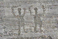Petroglyph, rock carving, of two warriors with swords carved by the ancient Camuni people in the iron age between  900-1200 BC. Rock 26-27, Foppi di Nadro, Riserva Naturale Incisioni Rupestri di Ceto, Cimbergo e Paspardo, Capo di Ponti, Valcamonica (Val Camonica), Lombardy plain, Italy .<br /> <br /> Visit our PREHISTORY PHOTO COLLECTIONS for more   photos  to download or buy as prints https://funkystock.photoshelter.com/gallery-collection/Prehistoric-Neolithic-Sites-Art-Artefacts-Pictures-Photos/C0000tfxw63zrUT4<br /> If you prefer to buy from our ALAMY PHOTO LIBRARY  Collection visit : https://www.alamy.com/portfolio/paul-williams-funkystock/valcamonica-rock-art.html