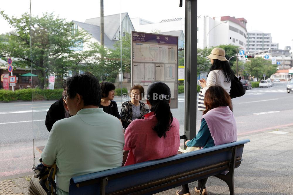bus stop with people waiting Yokohama Japan
