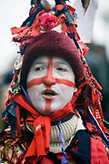 A performer from The Lions Part company dressed as St George takes part in an annual traditional free theatre celebrating a 'wassail' celebration to herald the new year. Bankside, London, UK. To celebrate the New Year, actors (The Bankside Mummers) associated with the Lion's Part company from the Globe Theatre, perform in traditional costume and entertain the crowds by the Thames. Participants dressed as St George and the Holly Man in the winter guise of the Green Man (a traditional pagan nature symbol) lead a procession through the streets toasting the seasons.