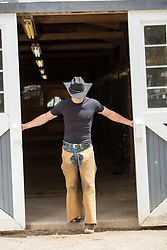 handsome All American cowboy in a barn