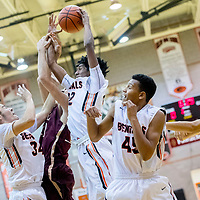 Gallup Bengal Zakarri Fields (22), center, pulls down a rebound from the Belen Eagles at Gallup High School Saturday.