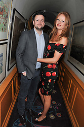 OLIVIA INGE and PETER DAVIES at the Johnnie Walker Blue Label and David Gandy partnership launch party held at Annabel's, 44 Berkeley Square, London on 5th February 2013.
