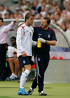 Photo: Glyn Thomas.<br />England v Ecuador. 2nd Round, FIFA World Cup 2006. 25/06/2006.<br /> England's David Beckham (L) leaves the field after being substituted.