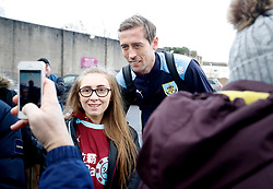 Burnley's Peter Crouch poses for a photograph with a fan outside the ground before the Premier League match at Turf Moor, Burnley.