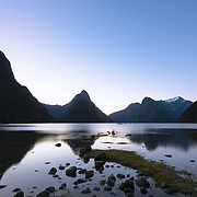 Milford Sound in Fjordland National Park with clear sky at dusk