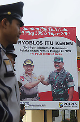 March 22, 2019 - Madiun, East Java, Indonesia - Benner, appealing to ''Nyoblos That It's Cool'' was seen from behind a joint officer who was carrying out the Apple Title Troops on the courtyard of the Madiun City Resort Police Station. Benner pictured the Head of the Indonesian National Police, General Police Tito Karnavian [left] along with the Commander of the Indonesian Armed Forces, Marshal Hadi Tjahjanto. The Benner reads Use Your Voting Rights in the Pileg and 2019 Presidential Election. The Indonesian National Army-National Police of the Republic of Indonesia Guarantees the Security of Election Implementation to the Polling Place. Indonesian National Army - National Police of the Republic of Indonesia Fortress of the Unitary State of the Republic of Indonesia. This activity in the framework of PAM Facing the 2019 Election (Credit Image: © Ajun Ally/Pacific Press via ZUMA Wire)