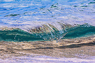 Wave breaking in crystal clear water, Hawaii, USA